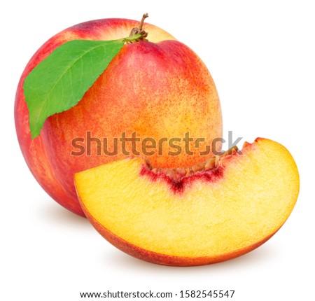 Isolated peaches (nectarines). Beautiful whole nectarine fruit with leaf and slice of fresh nectarine isolated on white background with clipping path
