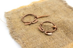 Isolated photos of a medieval copper fibula