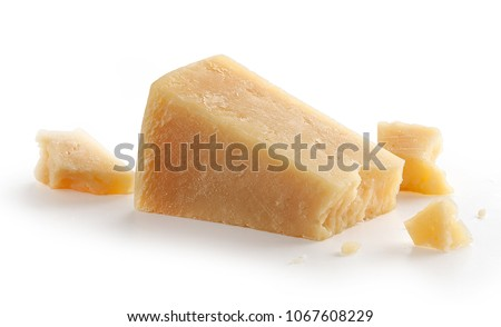 Isolated pieces of parmesan cheese on the white background