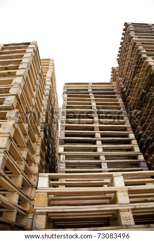 Isolated piles of wooden pallets