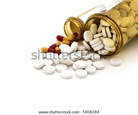 isolated pills and bottles