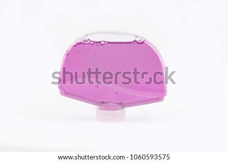 isolated pink liquid flavour in glass bottle on white background #1060593575