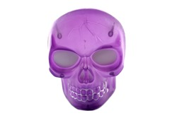 Isolated plastic purple skull used as halloween decoration.