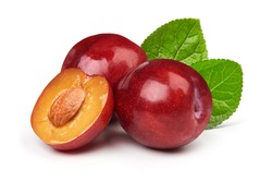 Isolated plums. One and a half of red plum fruit with leaves isolated on white background.