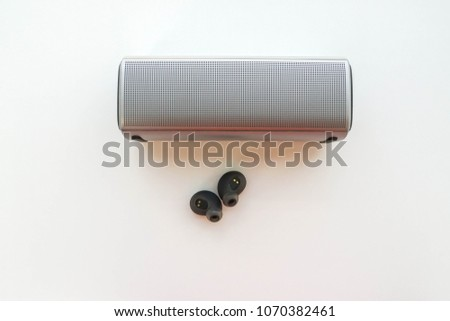 isolated portable speaker with wireless earphone for connection to listen music