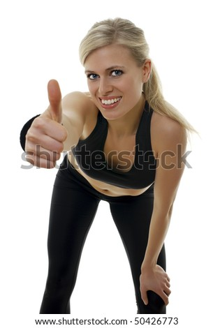 Isolated portrait of a beautiful blond fitness girl in black clothes.