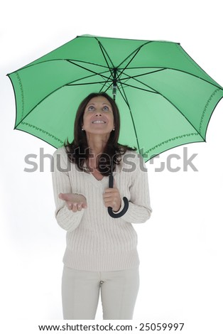 Isolated portrait of a beautiful business woman holding a red umbrella