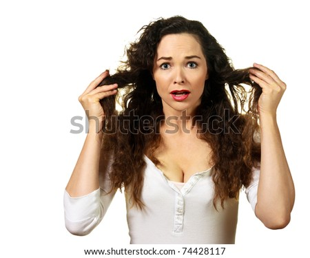 Isolated portrait of a beautiful young woman having a bad hair day