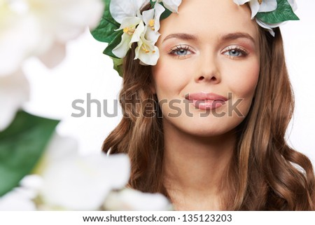Isolated portrait of a gorgeous young woman expressing the spirit of spring