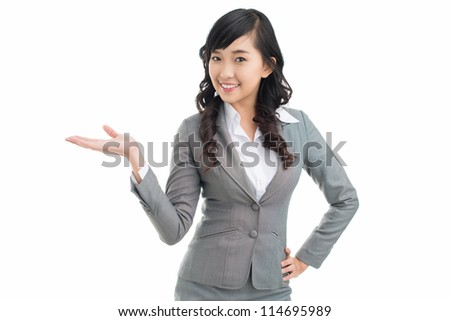 Isolated portrait of a happy girl presenting new product, copy-space provided