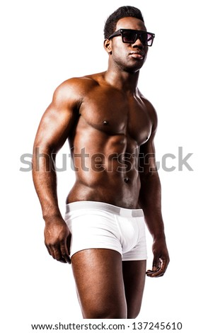 Isolated portrait of a masculine shirtless man in underwear.