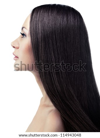 Isolated portrait of a young long-haired brunette in a profile