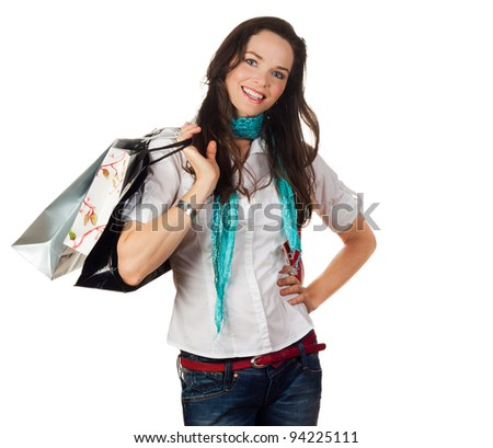 Isolated portrait of an attractive young woman holding shopping bags