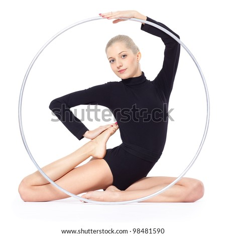 Isolated portrait of beautiful young blonde woman gymnast training calilisthenics exercise with hula hoop