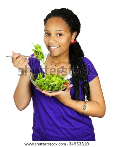 Isolated portrait of black teenage girl with salad bowl