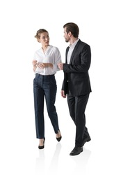 Isolated portrait of businesswoman and businessman walking together and talking. Concept of communication