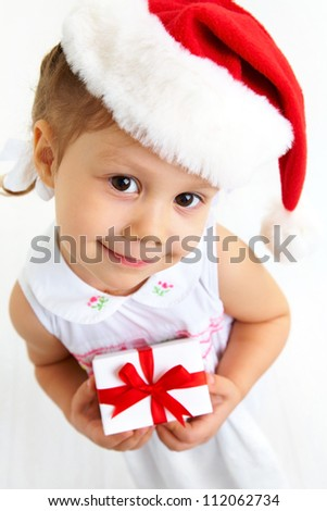 Isolated portrait of little cute girl with Christmas present
