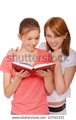 isolated portrait of two happy student girls reading the book