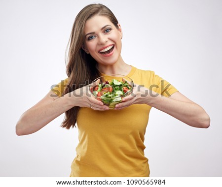 Isolated portrait on white background of woman holding glass bowl with vegetable salad. #1090565984