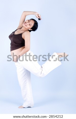 Isolated pregnant woman dancing while listening to her mp3 player