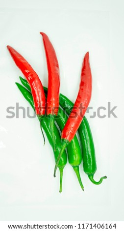 Isolated red chili and fresh green chilies in the white background #1171406164