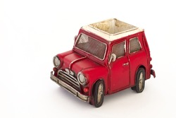 Isolated red vintage toy car.