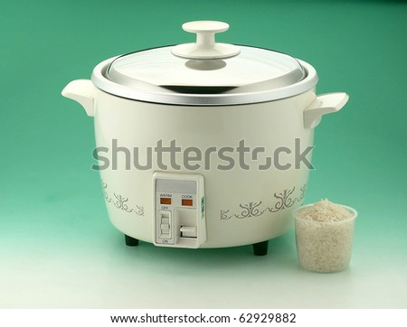 Isolated rice cooker and a measurement cup for house appliances