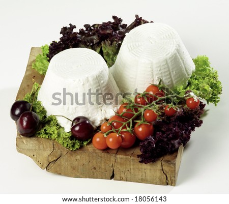 """isolated """"ricotta"""" cheese on cutting board"""