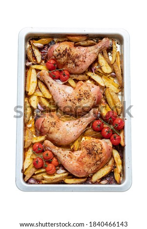 Isolated Roasted chicken leg with potato