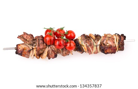 Isolated roasted meat on the metal skewer