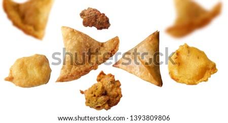 Isolated Samosa & Basin or Potato Pakora, Popular indian or pakistani street food snack called onion pakoda on white background, Ramadan iftar meal or Ramzan after food - Image