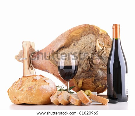 isolated serrano ham, wine and bread