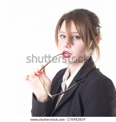 Isolated sexy teacher or business woman with glasses looking you