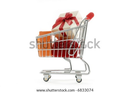 Isolated shopping cart full of gift boxes