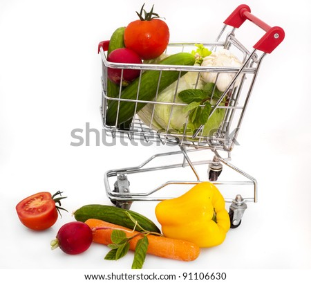 isolated shopping cart with vegetables