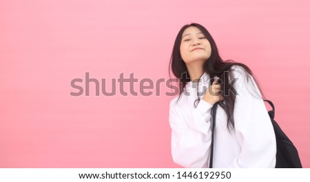 Isolated shot of pretty adult with long hair, broad smile, wears casual outfit, being entertained by friend during party, tilts head and looks with joy, dressed casually, Beautiful Asian models over   #1446192950