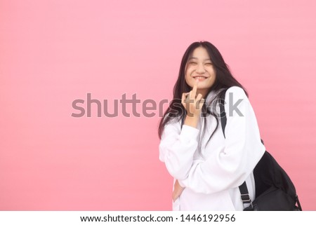 Isolated shot of pretty adult with long hair, broad smile, wears casual outfit, being entertained by friend during party, tilts head and looks with joy, dressed casually, Beautiful Asian models over   #1446192956