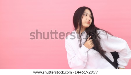 Isolated shot of pretty adult with long hair, broad smile, wears casual outfit, being entertained by friend during party, tilts head and looks with joy, dressed casually, Beautiful Asian models over   #1446192959