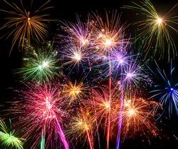 Isolated shots of fireworks blasts on black background