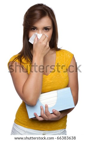 Isolated sick girl blowing nose