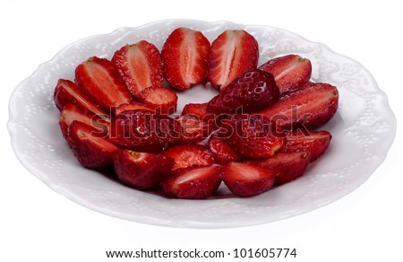 Isolated Sliced Strawberries on the Plate