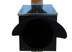 Isolated small panel of photovoltaic installed  above the traffic light. Concept for traffic sign to inform the drivers to lower speed driving vehicles. Clipping paths.