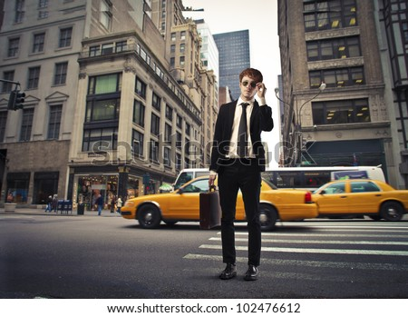 Isolated smiling young businessman on a city street