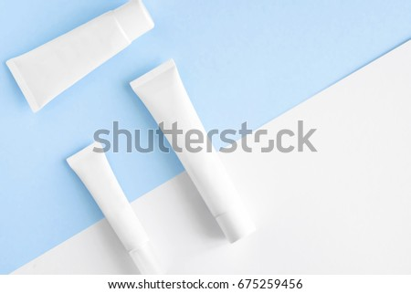 Isolated SPA cosmetic products, white tubes, branding mock up, top view on color background #675259456