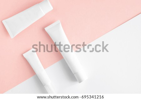 Isolated SPA cosmetic products, white tubes, branding mock up, top view on color background