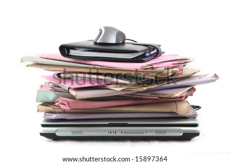 Isolated stack of folder with laptop computer and a mouse shot over white background