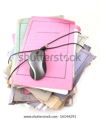 Isolated stack of folders with computer mouse shot over white background