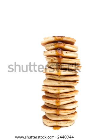 Isolated stack of pancakes dripping with maple syrup...