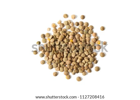 Isolated stack of uncooked lentils on white background from above. #1127208416