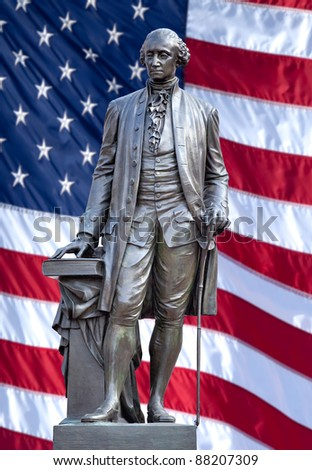 Isolated statue of George Washington, Independence Hall, Philadelphia, PA. The United States flag is in background. - stock photo